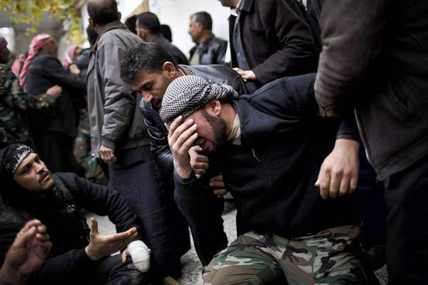 A Syrian rebel fighter cries during the funeral of a comrade in the town of Azaz. A Russian diplomat predicted that the fighting would become even more intense.