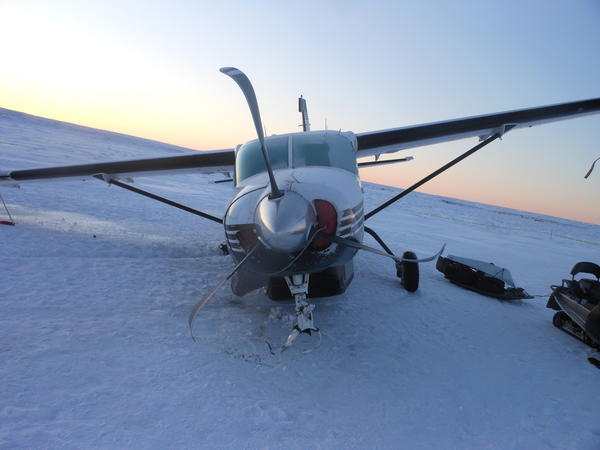 The National Transportation Safety Board is investigating two December small-plane crashes, including that of this Era Aviation Cessna 208 Caravan on sea ice near the village of Mekoryuk on Dec. 3. The NTSB says no injuries were reported by the nine people on board, who were picked up by villagers on snowmachines.