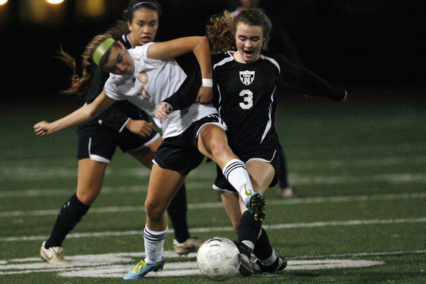 South Pasadena's Ryan Ramirez, left, and FSHA's Lauren Savo fight for the ball during a game at South Pasadena High School on Thursday, December 13, 2012.