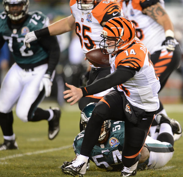 Cincinnati Bengals quarterback Andy Dalton (14) is sacked by Philadelphia Eagles defensive end Brandon Graham (54) early in the first quarter at Lincoln Financial Field in Philadelphia on Thursday.