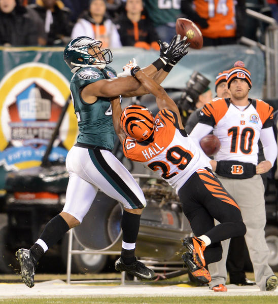 Philadelphia Eagles tight end Clay Harbor (82) goes for a pass over Cincinnati Bengals cornerback Leon Hall (29) at Lincoln Financial Field in Philadelphia on Thursday.