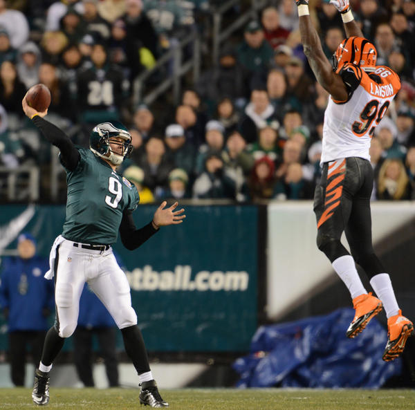 Philadelphia Eagles quarterback Nick Foles (9) passes over Cincinnati Bengals outside linebacker Manny Lawson (99) at Lincoln Financial Field in Philadelphia on Thursday.