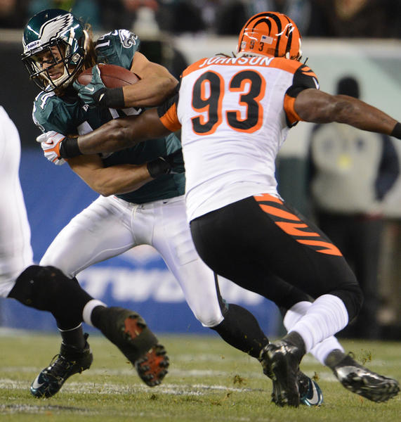 Philadelphia Eagles wide receiver Riley Cooper (14) tries to get by Cincinnati Bengals defensive end Michael Johnson (93) at Lincoln Financial Field in Philadelphia on Thursday.