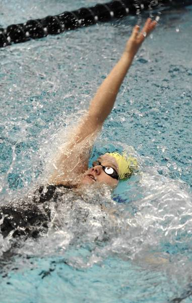 Taylor Iobst of Emmaus swims the backstroke leg of the 200 yard Medley Relay in the PIAA Class 3A Swimming and Diving Championships last March.