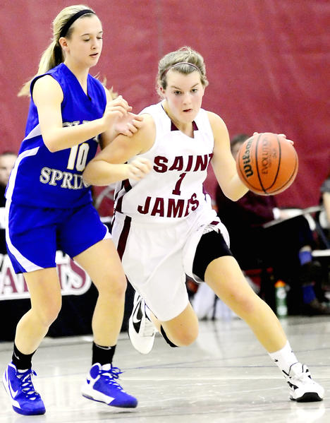 Saint James' Madison Fahey, right, drives past Clear Spring's Jenna Lipinski in the first half Thursday night.