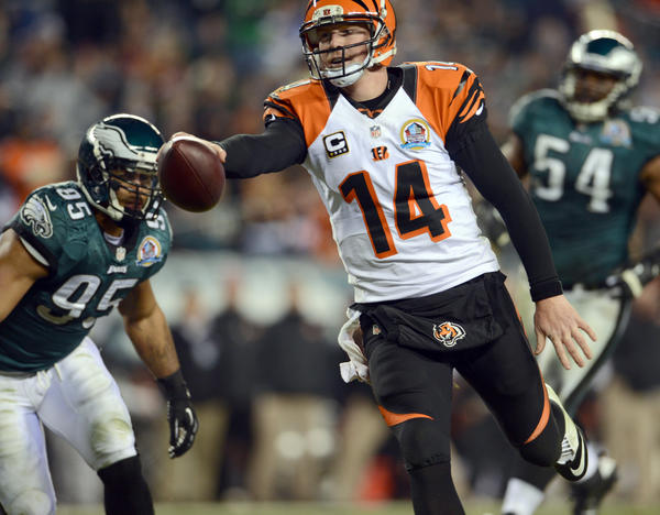 Cincinnati Bengals quarterback Andy Dalton (14) runs the ball for a touchdown at Lincoln Financial Field in Philadelphia on Thursday.