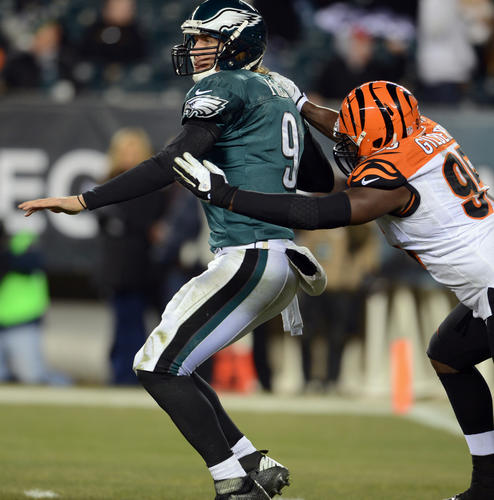 Philadelphia Eagles quarterback Nick Foles (9) is sacked by Cincinnati Bengals defensive end Wallace Gilberry (95) at Lincoln Financial Field in Philadelphia on Thursday.