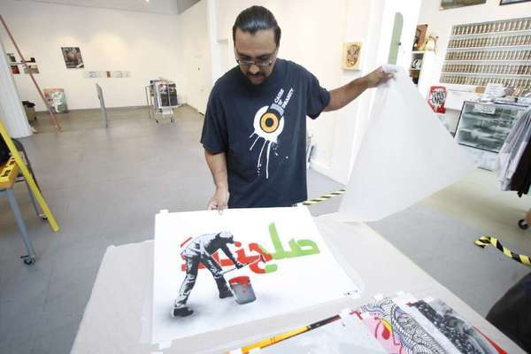 Man One, co-founder of Crewest Gallery, seen in 2009 preparing for a show on street art from Iran. Crewest is closing after more than 10 years devoted solely to graffiti art.