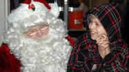 HOLTVILLE — Determined to speak to Santa Claus, 9-year-old Drake Jones stood in line with other children outside Holtville City Hall as the weather drizzled on.