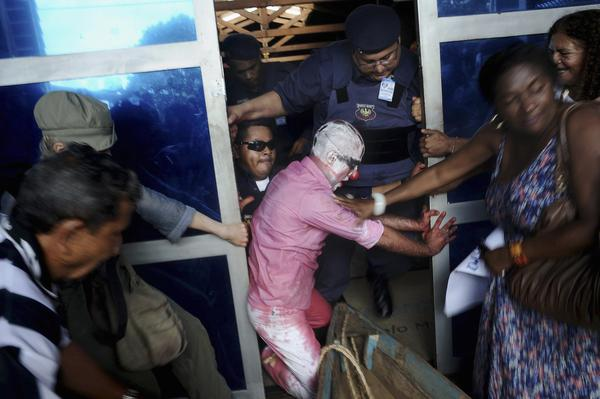 Brazilian actor-dancer Tiago Gambogi (C) fights with security guards at the entrance to the Norte Energia electric company headquarters, during a protest against the construction of the Belo Monte hydroelectric dam -- projected to be the world's third largest -- and its impact on the environment, in Altamira December 13, 2012.