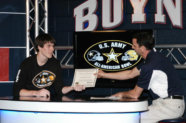 Boyne City High School senior Andrew Deneau is presented with an award during a filming of the Rambler Sports Network Thursday by RSN host Andy Bryant. A demo reel created by Andrew was one of four chosen as winners in a national video production competition.