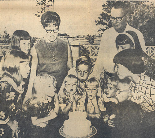 The Fischer family celebrated the quints' fifth birthday and other children's September birthdays in this photo from the Sept. 15, 1968, edition. From left at the table are Mary Magdalene 'Maggie,' Cindy (behind Mary Magdalene), Mary Ann, Mary Margaret 'Margie,' Mary Catherine 'Cathy' and James Andrew 'Jimmie.' The older children are, from left, Denise, Julie, Danny, Charlotte and Evelyn. In back are parents Mary Ann Darling Fischer and Andrew Fischer. Mary Ann Darling Fischer died Sunday in Aberdeen. At right, the front page of the American News the day the Fischer quints were born.