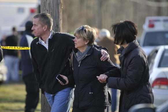 Chris and Lynn McDonnell, parents of shooting victim Grace, arrive at Sandy Hook Elementary School in Newtown Friday morning.