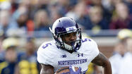 The Football Writers Association of America has named Northwestern's Venric Mark to its All-America team as a punt returner.