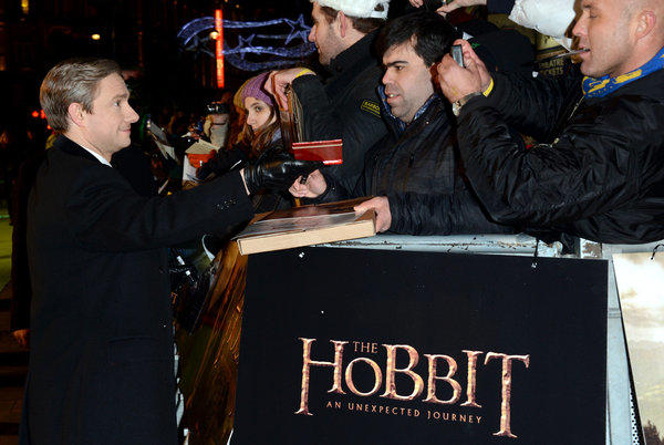 "Fans reach out to star Martin Freeman at the premiere of ""The Hobbit: An Unexpected Journey"" in London"