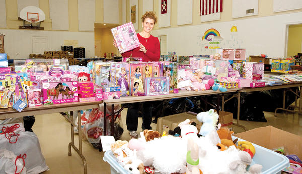 Teresa Potter of Charlevoix, helps sort a gym full of toys and packages given just prior to the 2010 Charlevoix Community Christmas Project distribution day at Bethany Lutheran Church. This year's distribution will take place on Friday, Dec. 21.