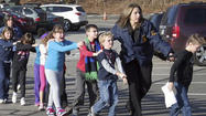 NEWTOWN, Conn. (AP) - A man killed his mother at their home and then opened fire Friday inside the elementary school where she taught, massacring 26 people, including 20 children, as youngsters cowered in fear to the sound of gunshots reverberating through the building and screams echoing over the intercom.