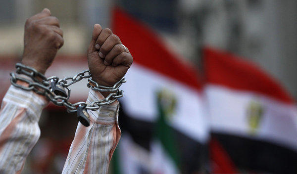 A protester in Cairo shows his chained hands during a demonstration against a proposed constitution.
