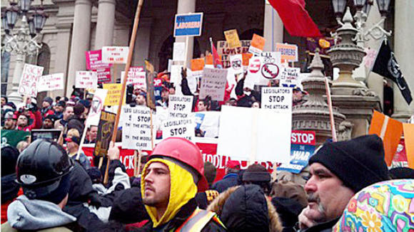 Capitol officials estimated 12,5000 demonstrators protested the right-to-work bills in Lansing, the largest demonstration in memory, according to the Lansing State Journal.