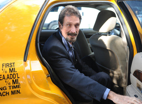 John McAfee arrives for an interview in Miami on Friday. McAfee, who is wanted for questioning in the shooting of an American citizen in Belize, was denied asylum by Guatemala.