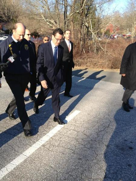 Gov. Dannel Malloy walks from the crime scene toward a nearby senior center.