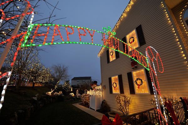 Traditional white Christmas lights and red bows decorate a home at 6887 Lincoln Drive in Lower Macungie. See this house on part three ('Leslie's macaroons') of Bill White's 2012 Christmas lights tour.
