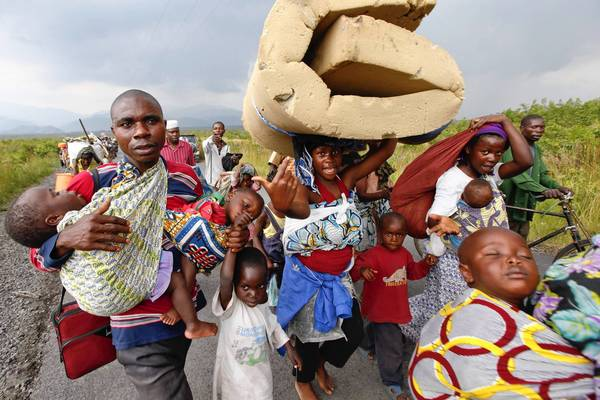 Congolese flee with their belongings to avoid fighting between rebels and government troops last month.