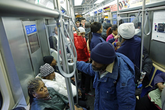 Passengers ride a crowded, outbound 5000 Series CTA Green Line train.