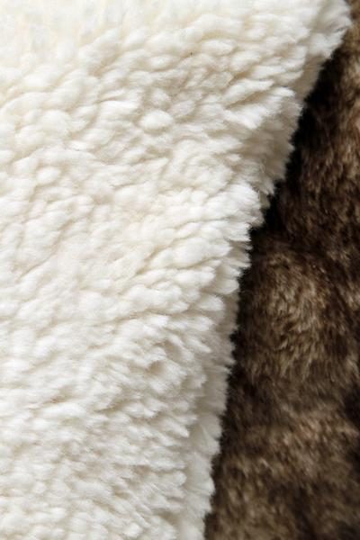"The Faux Sheepskin pillow is shown on top. ""I like the size and the give,"" a judge said. ""I like that both sides are the same.""