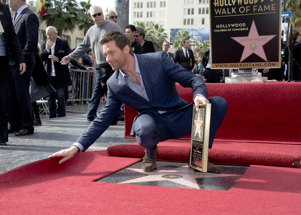 "Hugh Jackman got his star on Hollywood's Walk of Fame on Thursday, introduced by Jay Leno and supported by his ""Les Miserables"" costars Anne Hathaway and Amanda Seyfried.  ""I believe this is the 2,487th star on the Walk of Fame,"" Jackman told the crowd, ""however, apart from Lassie, I'm the only one who's gotten it for playing the same character in 15 movies.""  <br><br> <strong>Full story:</strong> <a href=""http://www.latimes.com/entertainment/gossip/la-et-mg-hugh-jackman-star-hollywood-walk-of-fame-les-miserables-20121214,0,320301.story"">Hugh Jackman gets his star on Hollywood Walk of Fame</a> 