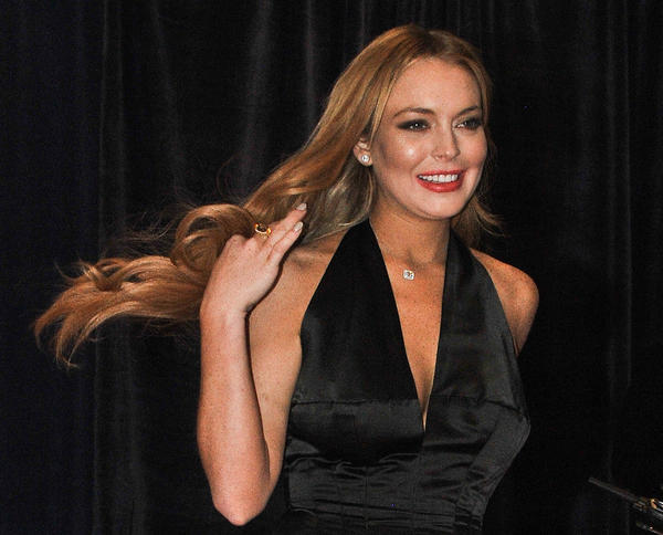 "In light of recent misdemeanor charges, Lindsay Lohan is once again looking at the possibility of jail time.  In a seemingly endless string of troubles, the actress' probation stemming from a 2011 jewelry theft case has been revoked -- after the ""Liz & Dick"" star was slapped with three misdemeanor counts from a June traffic accident.  Lohan's longtime counsel Shawn Holley appeared in Los Angeles on Lohan's behalf on Wednesday, where an updated court date of Jan. 15 was given to decide her fate. <br><br> <strong>Full story:</strong> <a href=""http://www.latimes.com/entertainment/gossip/la-et-mg-lindsay-lohan-probation-revoked-california,0,3618403.story"">Lindsay Lohan's probation is revoked. What happens next?</a> 