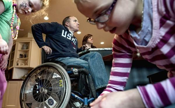 Air Force veteran Sean Halstead is shown with his wife Sarah and two of their children at their home in Rathdrum, Idaho. Halstead sustained a spinal cord injury during training and the couple couldn't have had children without in vitro fertilization. They were shocked to learn the VA doesn't cover the procedure.