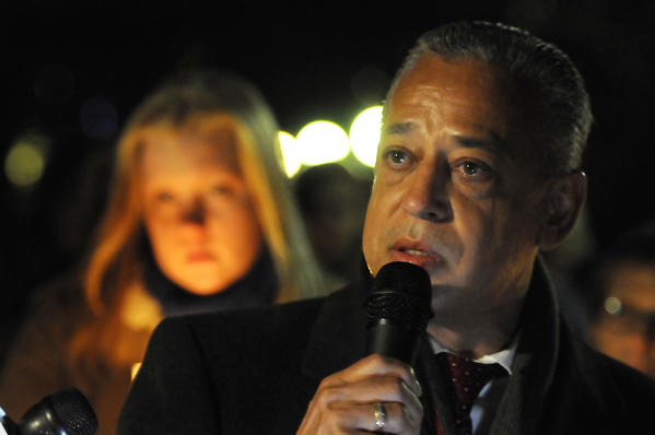 Hartford Mayor Pedro Segarra speaks emotionally in the day at a candlelight vigil in Bushnell Park Friday about the students and teachers who died at Sandy Hook Elementary School in Newtown earlier.