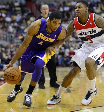 The Lakers' Darius Morris drives against Wizards guard Bradley Beal at the Verizon Center in Washington.