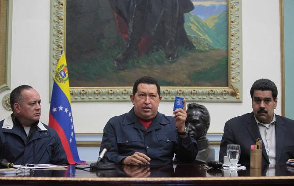 President of Venezuela, Hugo Chavez, center, said that he will return to Cuba to undergo further cancer during a national broadcast in Caracas, Venezuela. On his left is his vice president, Nicolas Maduro, and on his right was Diosdado Cabello, president of the National Assembly.