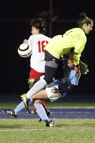 La Salle's keeper Sam Dier, top, tries to block the ball from CV's Lisa Kang during a game at La Salle High School in Pasadena on Friday, December 14, 2012.