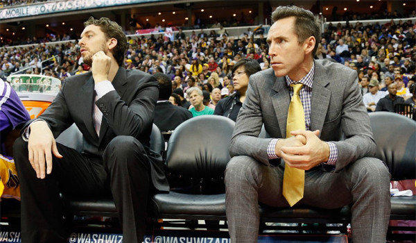 Pau Gasol and Steve Nash sit on the bench during the second half during the Lakers' win over the Washington Wizards, 102-96.