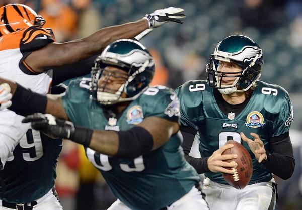Philadelphia Eagles quarterback Nick Foles (9) under pressure against the Cincinnati Bengals at Lincoln Financial Field in Philadelphia on Thursday.