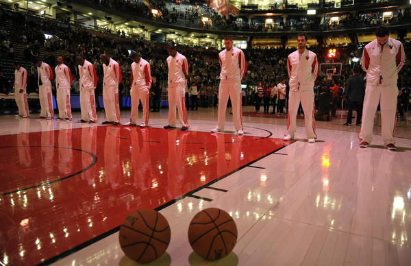 Members of the Toronto Raptors observe a moment of silence in remembrance of the shooting victims at Sandy Hook Elementary School in Newtown, Conn. before their NBA basketball game in Toronto.