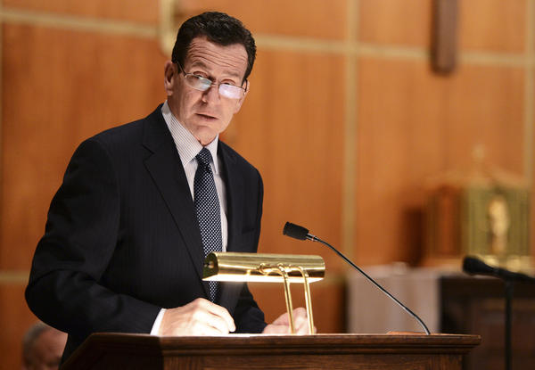 Dannel Malloy, Governor of Connecticut speaks to mourners gathererd inside the St. Rose of Lima Roman Catholic Church at a vigil service for victims of the Sandy Hook Elementary School shooting.
