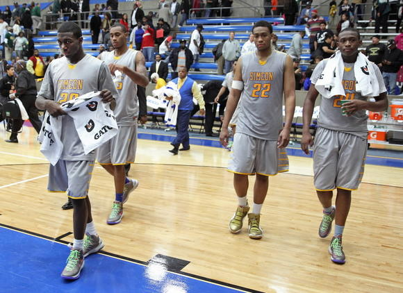 From left to right, Simeon's Kendrick Nunn, Russell Woods, Jabari Parker and Kendall Pollard walk off the court Thursday after their loss to DeSoto at Grand Prairie High School in Texas.