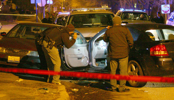 Chicago police investigate a shooting at 54th and Komensky Avenue.