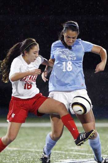 Crescenta Valley senior Katie Callister, right, scored a rebound goal in the first minute of extra time to secure the win for the Falcons.