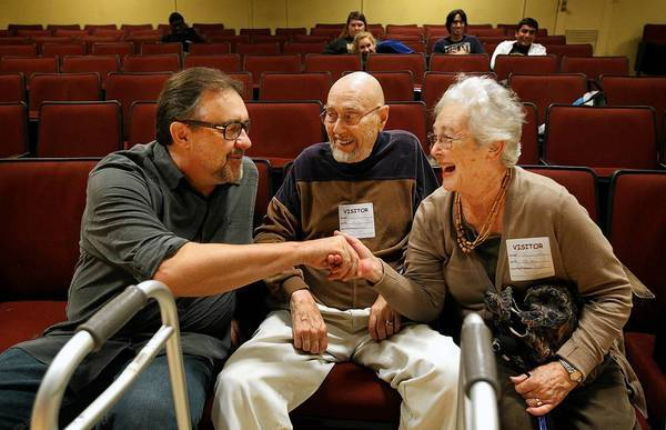 "Don Hahn, left, who executive produced Disney classics including ""Beauty and the Beast"" and ""The Lion King,"" chats with Robert Newman and his wife, Tomi, at Bellflower High School. Alumni of the school are helping to raise money for the school's arts programs."
