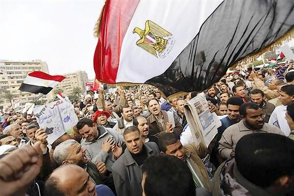 Supporters of Egyptian President Mohamed Mursi and members of the Muslim Brotherhood chant pro-Mursi slogans during a rally in Rabaa El Adaweya Mosque square in Cairo.