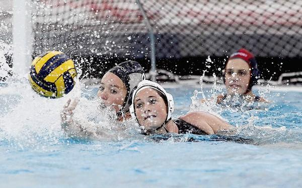 Newport Harbor's Avery Peterson battles for possession of a ball against Foothill's Hannah Lapkin during a nonleague game at Newport Harbor High on Friday.