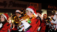 IMPERIAL —Flickering lights on marching band members' instruments, clubs and floats bounced off the wet streets of this city, bringing awe to thousands of smiling people present at the 10th annual Parade of Lights held Friday night.
