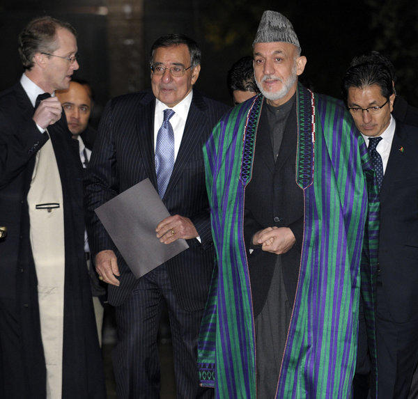 Defense Secretary Leon E. Panetta and Afghanistan President Hamid Karzai arrive for a news conference at the presidential palace in Kabul, Afghanistan on Thursday. Negotiators from their two governments are holding talks to define the U.S. role in the South Asian nation after American combat troops pull out at the end of 2014.