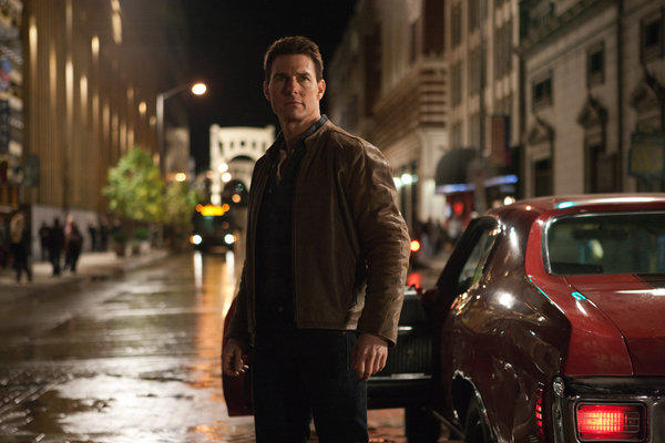 "Tom Cruise in a scene from ""Jack Reacher."" Cruise plays a former military cop investigating a sniper case. Paramount has postponed the premiere of ""Jack Reacher"" scheduled for Saturday, Dec. 15, in Pittsburgh, due to the Sandy Hook Elementary School shooting in Newtown, Conn."