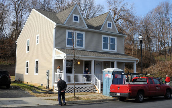 People arrive for dedication ceremony on Saturday at the Habitat for Humanity of the Lehigh Valley Home at 623 Charles Street on South Side Easton. Christine Monico, was presented the keys to the home where she will live with her son Adriel Canales, 14, and her daughter Hailey Batista, 5.